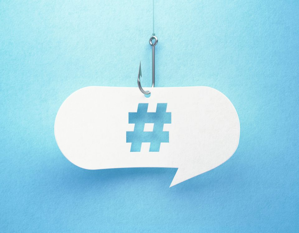 Hashtag symbol in a message bubble hanging on a fish hook.