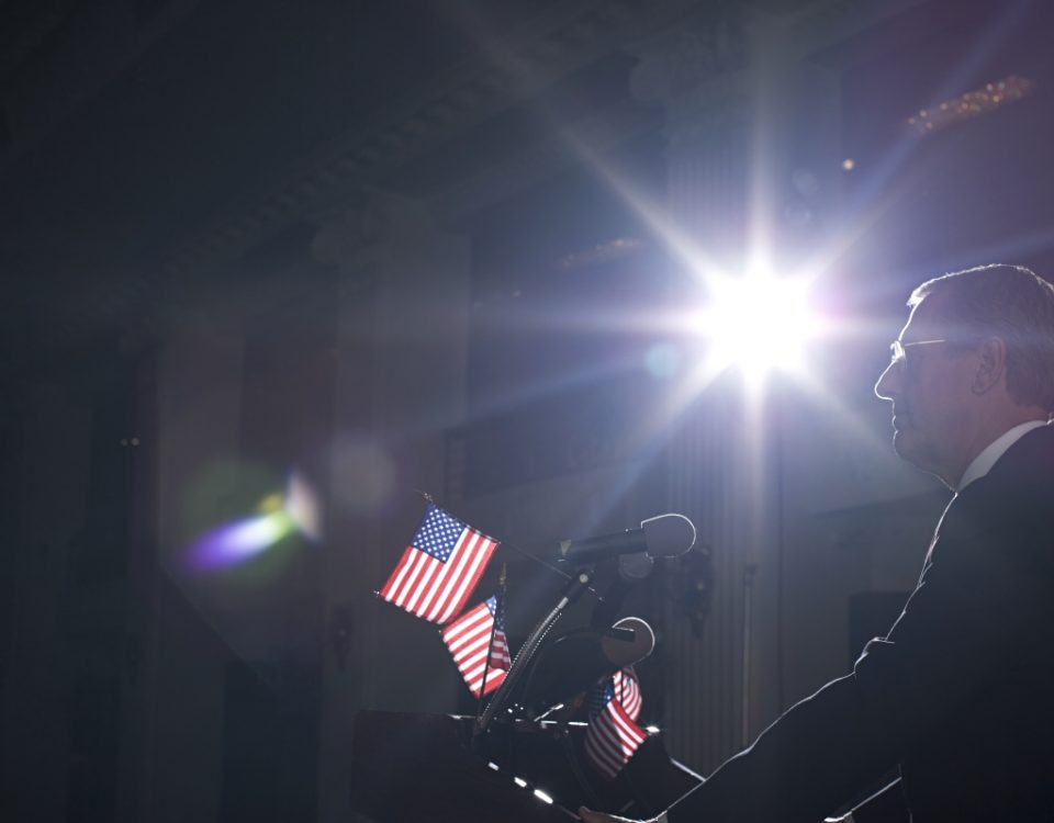 Politician speaking to a crowd for American elections.